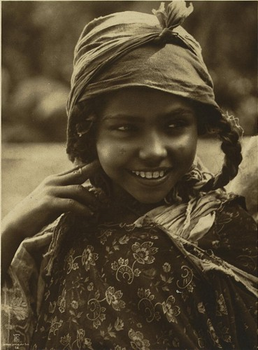 [Tunisian girl, head-and-shoulders portrait, facing front]